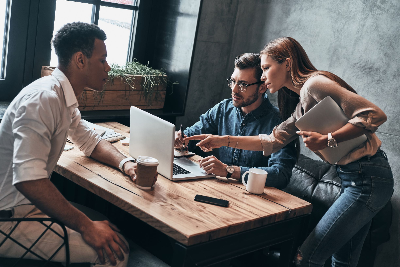 People meeting over computer work
